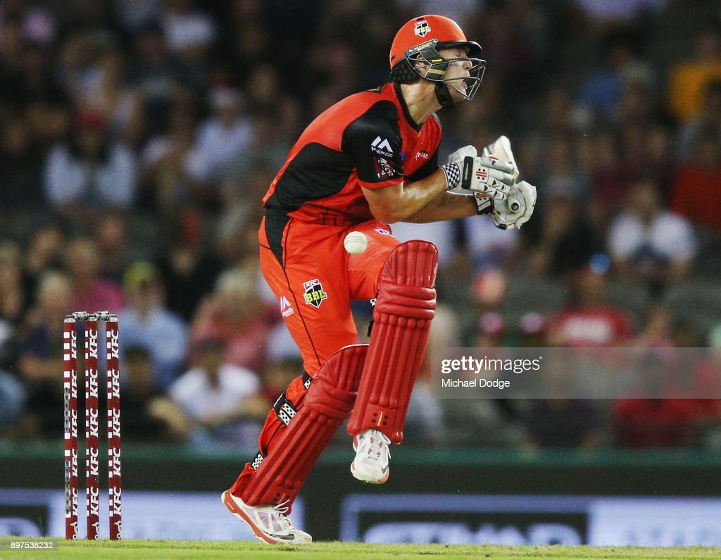 Cameron White of the Renegades is hit in the groin during the Big Bash League match between the Melbourne Renegades and the Brisbane Heat at Etihad Stadium on December 23, 2017 in Melbourne, Australia.