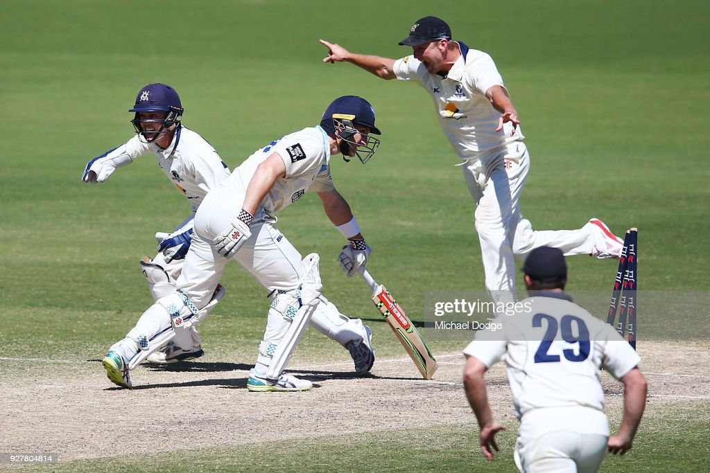 Cameron White of Victoria (R) celebrates winning the match after Peter Neville of New South Wales is stumped by keeper Seb Gotch of Victoria during day five of the Sheffield Shield match between Victoria and New South Wales at Junction Oval on March 6, 2018 in Melbourne, Australia.