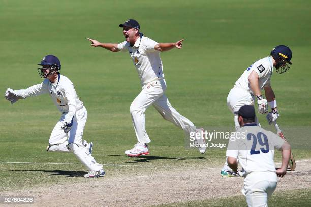 Cameron White of Victoria celebrates winning the match after Peter Neville of New South Wales is stumped by keeper Seb Gotch of Victoria during day...