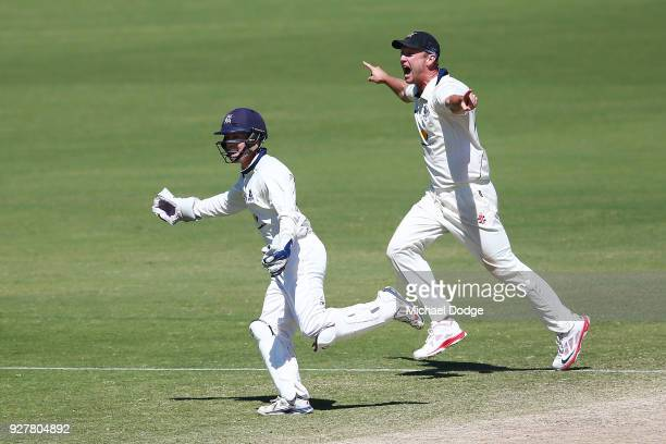 Cameron White of Victoria celebrates winning the match with Seb Gotch during day five of the Sheffield Shield match between Victoria and New South...