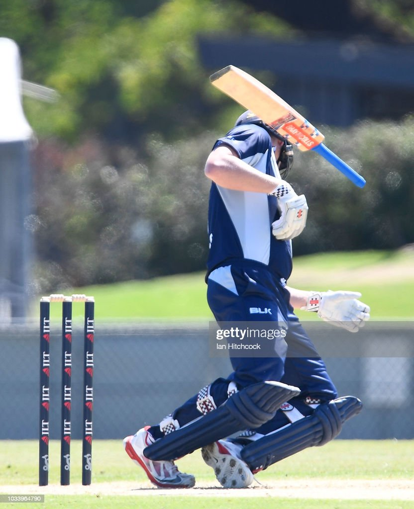 Cameron White of Victoria is hit in the head with the ball during the JLT One Day Cup match between Queensland and Victoria at Riverway Stadium on September 16, 2018 in Townsville, Australia.