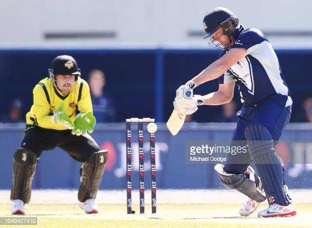 Cameron White of Victoria misses shot to be later stumped by Josh Inglis of Western Australia during the JLT One Day Cup between Victoria and Western...