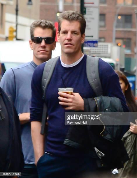 Cameron Winklevoss and Tyler Winklevoss are seen walking in soho on October 15 2018 in New York City