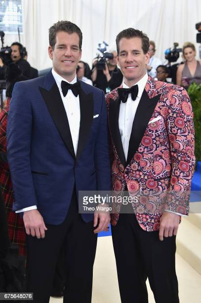 Cameron Winklevoss and Tyler Winklevoss attend the Rei Kawakubo/Comme des Garcons Art Of The InBetween Costume Institute Gala at Metropolitan Museum...