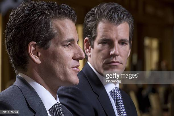 Cameron Winklevoss, chief executive officer and co-founder of Gemini Trust Company LLC, left, speaks as Tyler Winklevoss, chief financial officer and...