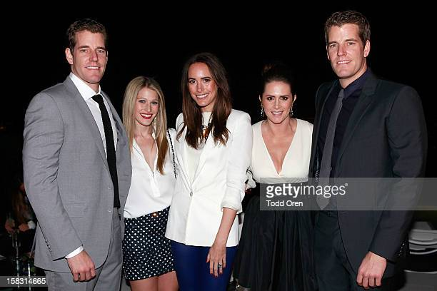 Cameron Winklevoss Erica Bell TV Host Louise Roe Katie Finnegan and Tyler Winklevoss pose at the Hukkster Holiday Party at a Private Residence on...