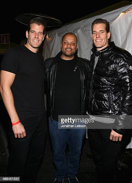 Cameron Winklevoss Jay Brown and Tyler Winklevoss attend the Roc Nation and Live Nation Raptor House on March 15 2015 in Austin Texas