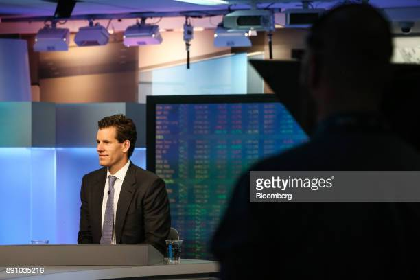 Cameron Winklevoss president and cofounder of Gemini listens during a Bloomberg Television interview in New York US on Tuesday Dec 12 2017...