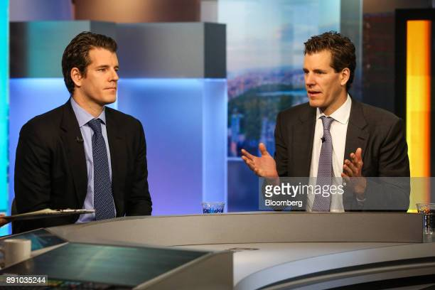 Cameron Winklevoss president and cofounder of Gemini right speaks as Tyler Winklevoss chief executive officer and cofounder of Gemini listens during...