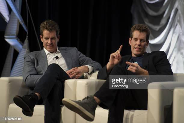 Cameron Winklevoss, president and co-founder of Gemini Trust Co., right, speaks as Tyler Winklevoss, chief executive officer and co-founder of Gemini...