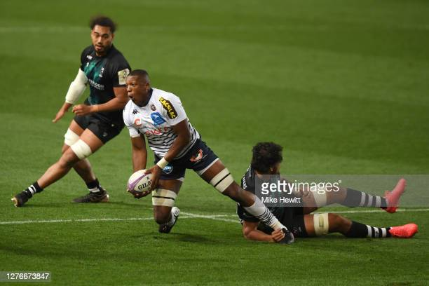 Cameron Woki of Bordeaux-Begles is tackled by Steve Luatua of Bristol Bears during the European Rugby Challenge Cup Semi Final match between Bristol...