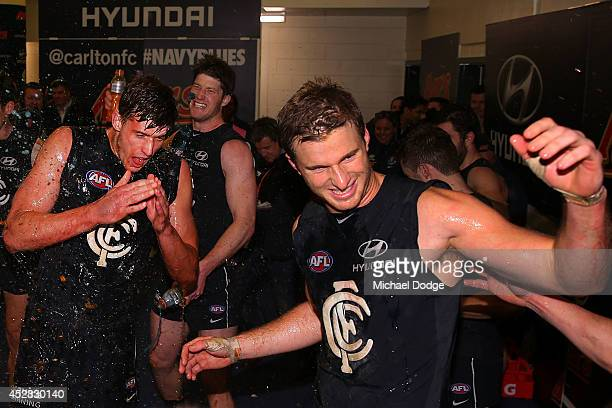 Cameron Wood and Lachie Henderson of the Blues sing the song after their win during the round 18 AFL match between the Carlton Blues and the North...