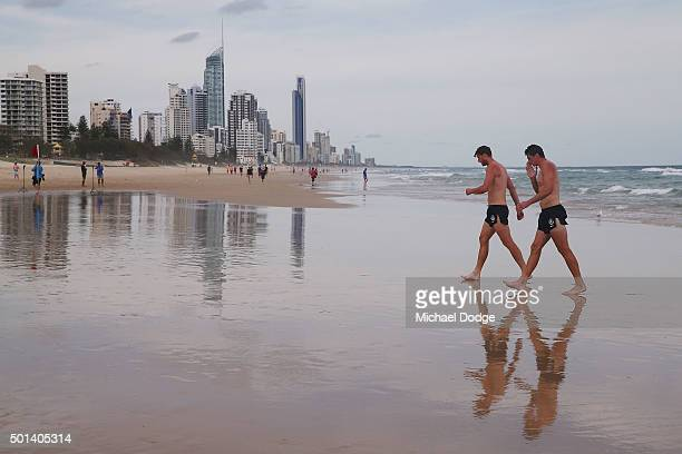 Cameron Wood and Matthew Kreuzer walk back from a recovery session a the beach during the Carlton Blues AFL preseason training camp on December 15...