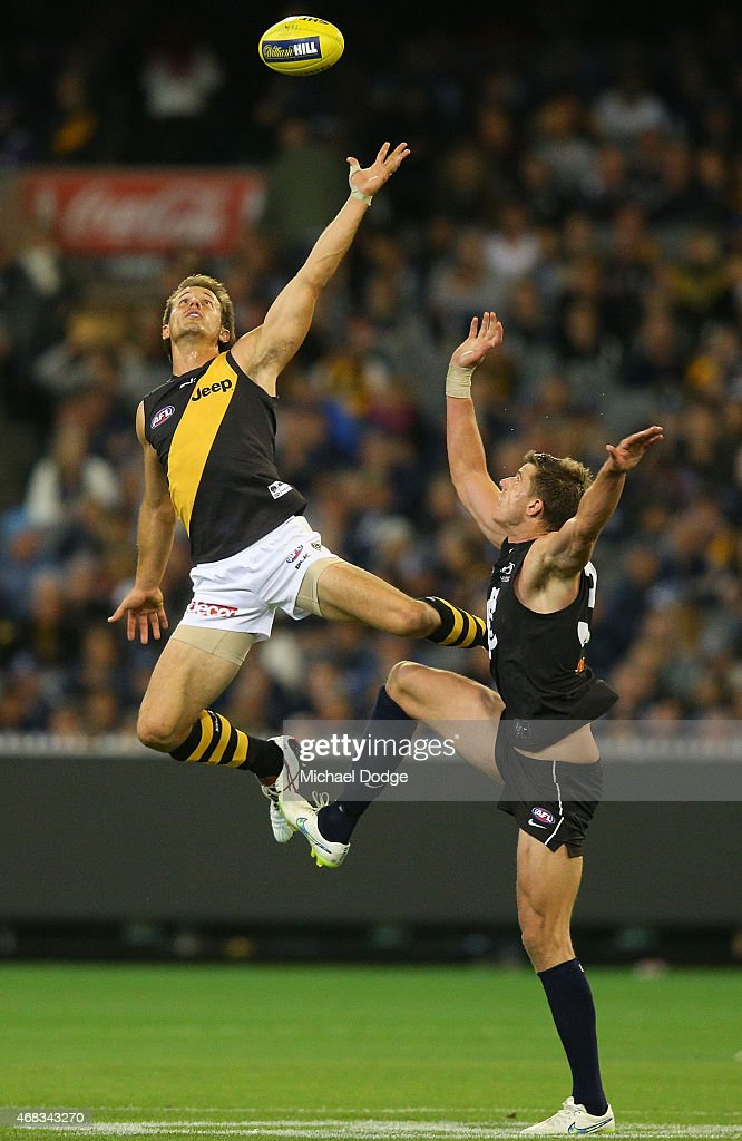 Cameron Wood of the Blues (R) competes for the ball against Ivan Maric of the Tigers during the round one AFL match between the Carlton Blues and the Richmond Tigers at Melbourne Cricket Ground on April 2, 2015 in Melbourne, Australia.