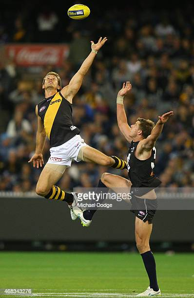 Cameron Wood of the Blues competes for the ball against Ivan Maric of the Tigers during the round one AFL match between the Carlton Blues and the...