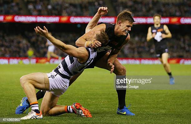 Cameron Wood of the Blues wrestles Joel Selwood of the Cats to the ground in frustration after already giving away a free kick to him during the...