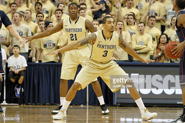 Cameron Wright of the Pittsburgh Panthers defends against the Connecticut Huskies at Petersen Events Center on January 19, 2013 in Pittsburgh,...