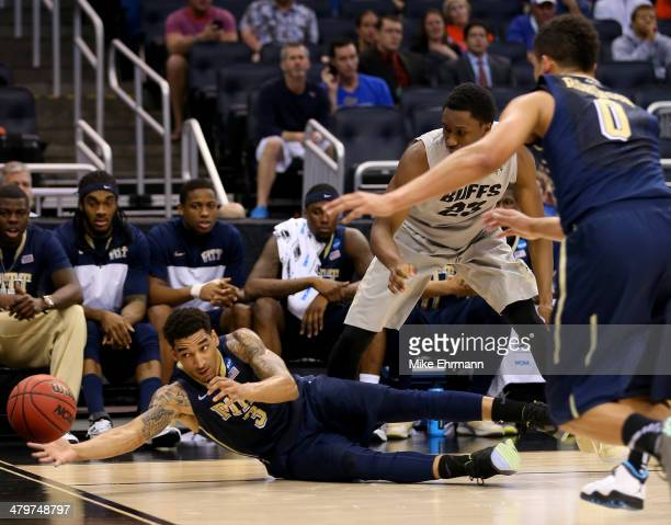 Cameron Wright of the Pittsburgh Panthers dives for a loose ball against the Colorado Buffaloes in the first half during the second round of the 2014...