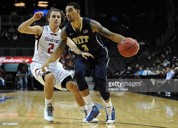 Cameron Wright of the Pittsburgh Panthers drives against Dusty Hannahs of the Texas Tech Red Raiders during the second half at Barclays Center on...