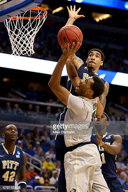 Cameron Wright of the Pittsburgh Panthers goes up for a block against Tre'Shaun Fletcher of the Colorado Buffaloes in the first half during the...