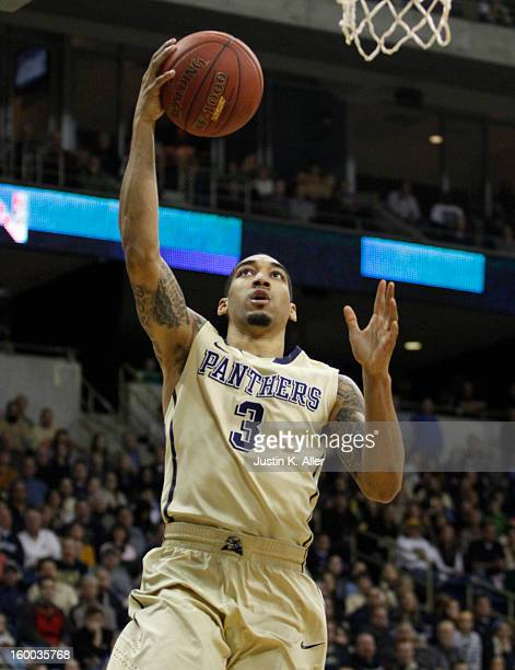 Cameron Wright of the Pittsburgh Panthers handles the ball against the Connecticut Huskies at Petersen Events Center on January 19, 2013 in...