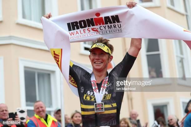 Cameron Wurf of Australia celebrates after he wins the Men's race during the Ironman Wales competiton on September 10 2017 in Tenby Wales
