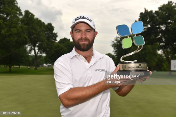 Cameron Young holds the trophy after winning the AdventHealth Championship at Blue Hills Country Club on May 23, 2021 in Kansas City, Missouri. Young...
