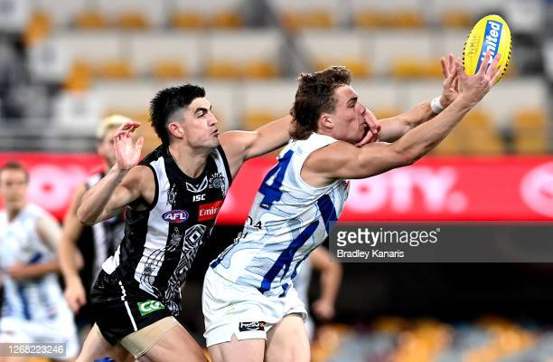 Cameron Zurhaar of North Melbourne takes a mark as he is pressured by the defence of Brayden Maynard of the Magpies during the round 13 AFL match...