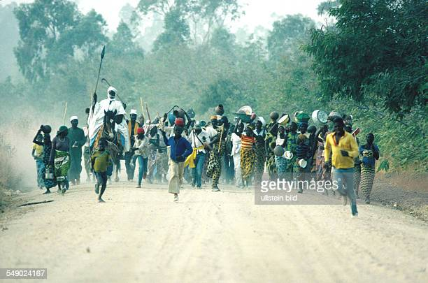 A Moslem Fulani emir and his followers racing down a dirt road