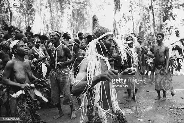 Baka pygmies in the rain forest Here Healer dancing during a healing ceremony