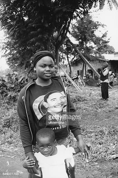CMR Cameroon Africa Grassland Bafut A Woman with a Obama Tshirt