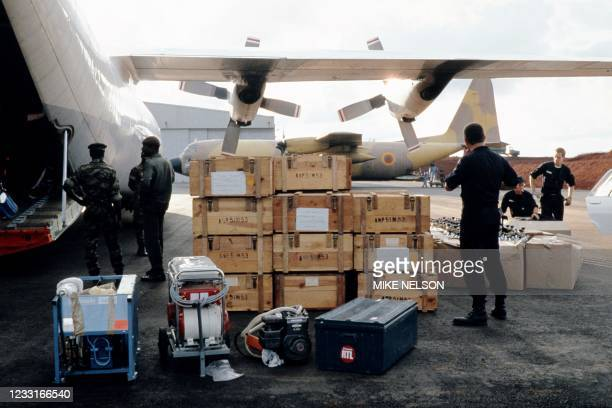 Cameroon army soldiers unload international aid at Bamenda airport on August 29, 1986 for victims and displaced people affected by the volcanic gas...