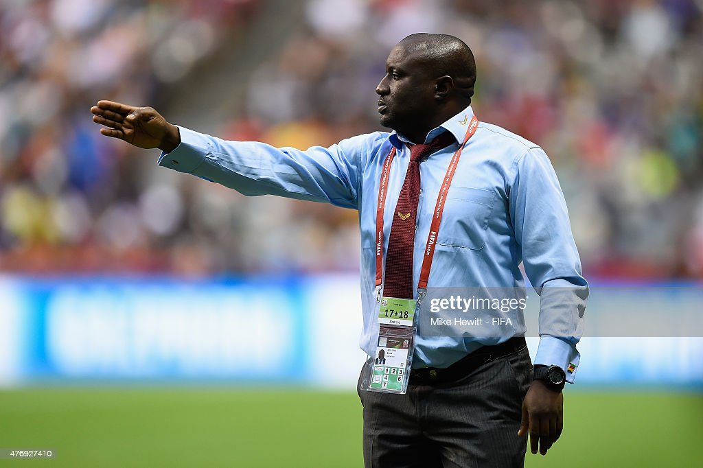 Cameroon coach Enow Ngachu issues instructions during the FIFA Women's World Cup 2015 Group C match between Japan and Cameroon at BC Place Stadium on June 12, 2015 in Vancouver, Canada.