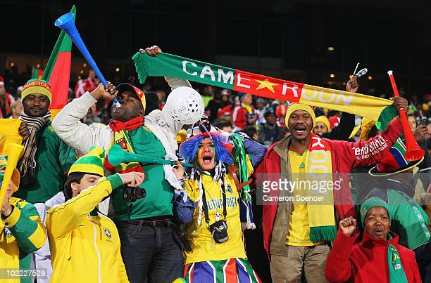 Cameroon fans blow vuvuzelas as they enjoy the atmosphere ahead of the 2010 FIFA World Cup South Africa Group E match between Cameroon and Denmark at...