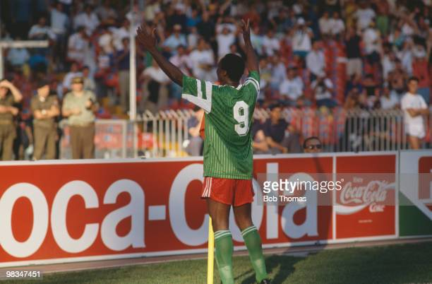 Cameroon footballer Roger Milla celebrates after scoring against Colombia at the San Paolo Stadium in Naples during the round of 16 match 1990 Italy...