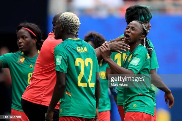 Cameroon Head Coach Alain Djeumfa tries to calm Ajara Nchout of Cameroon as she reacts after her goal is disallowed via a VAR decision during the...