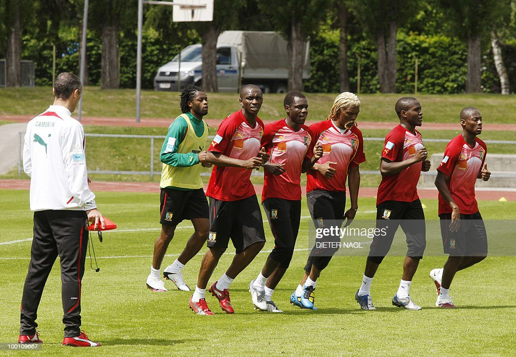 Cameroon national football team coach France's Paul Le Guen (L) looks at his players running during a training session on May 21, 2010 in Lienz, some 550 kilometers southwest from Vienna. The Cameroon national team on May 20 arrived in Austria for a training camp ahead of the June 11-July 11 World Cup in South Africa.The team and coach Paul Le Guen touched down in the southeastern city of Klagenfurt and headed immediately for Lienz, where they will be based until May 28.