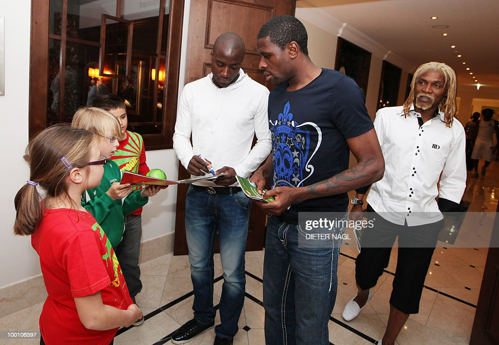 Cameroon national football team players give autographs to young fans at their hotel on May 20, 2010 in Lienz some 550 kilometers southwest from Vienna.