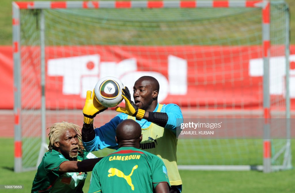 Cameroon national football team players Guy Roland Ndy Assembe (C), Rigobert Song (L) train during their practice session at their training camp in Lienz in Austria on May 24, 2010 prior to the FIFA World Cup 2010 in South Africa.
