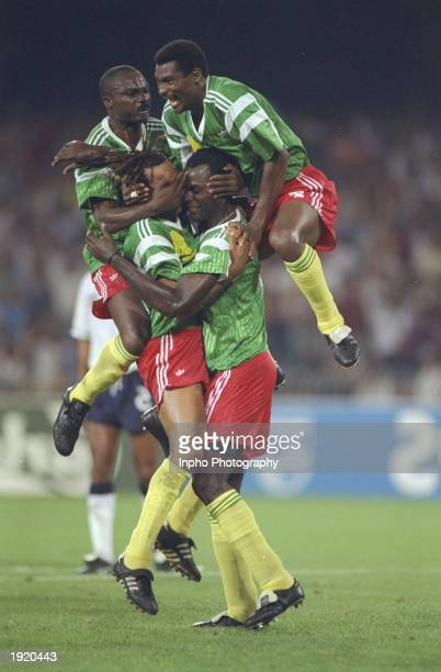 Cameroon players celebrate a goal during the World Cup quarterfinal match against England in Italy England won 32 after extra time Mandatory Credit...
