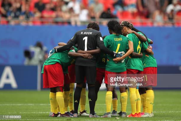 Cameroon players huddle during the 2019 FIFA Women's World Cup France Round Of 16 match between England and Cameroon at Stade du Hainaut on June 23,...