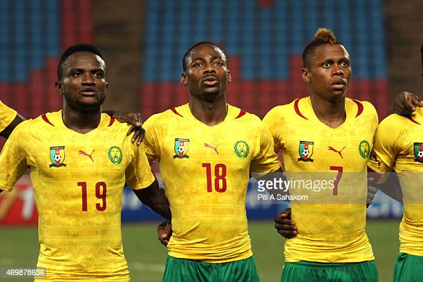 Cameroon players Mandjang Kombi Eyong Enoh Clinton N'Jie pose for a team picture ahead of the international friendly match between Thailand and...