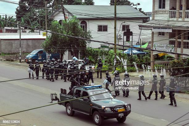 Cameroon police officials with riot equipment patrol along a street in the administrative quarter of Buea some 60kms west of Douala on October 1 2017...