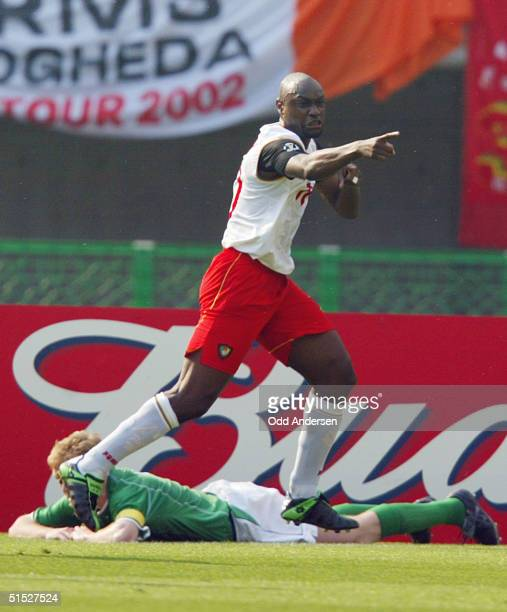 Cameroon striker Patrick Mboma celebrates after he scored during the Ireland/Cameroon Group E match of the first round of the 2002 FIFA World Cup...