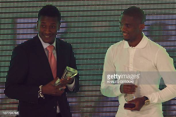Cameroon striker Samuel Eto'o poses with Ghana's footballer Asamoah Gyan during the annual CAF awards ceremony in Cairo on December 20 2010 Eto'o was...
