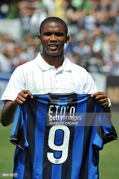 Cameroon striker Samuel Eto'o poses with his new jersey at Inter Milan training centre in Appiano Gentile on July 28, 2009 . He is part of a swap...