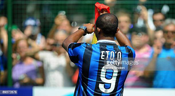 Cameroon striker Samuel Eto'o poses with his new jersey during his presentation at Inter Milan's training centre in Appiano Gentile on July 28, 2009...