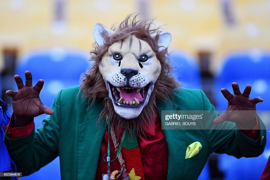 A Cameroon supporter cheers ahead of the 2017 Africa Cup of Nations group A football match between Cameroon and Gabon at the Stade de l'Amitie Sino-Gabonaise in Libreville on January 22, 2017. / AFP / GABRIEL