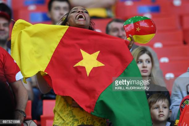 A Cameroon supporter cheers ahead of the 2017 Confederations Cup group B football match between Cameroon and Chile at the Spartak Stadium in Moscow...