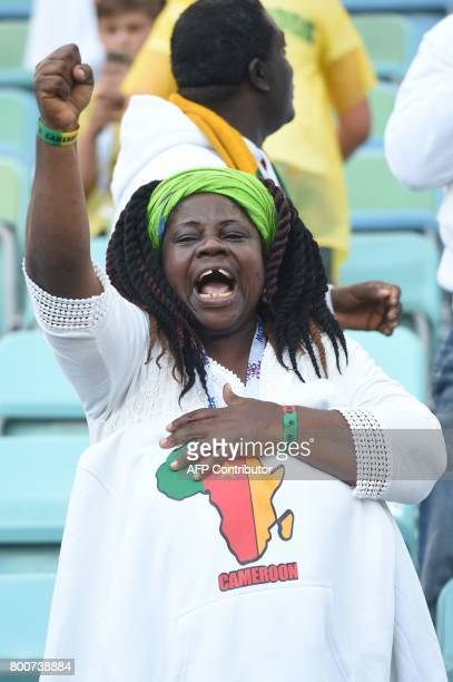 A Cameroon supporter cheers ahead of the 2017 FIFA Confederations Cup group B football match between Germany and Cameroon at the Fisht Stadium...